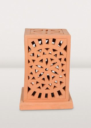 A+handcrafted+lantern+to+light+up+your+garden+walk.+Or+let+lively+patterns+splash+across+the+summer+deck+at+night+with+this+terracotta+candle+lantern+handcrafted+in+Bangladesh.