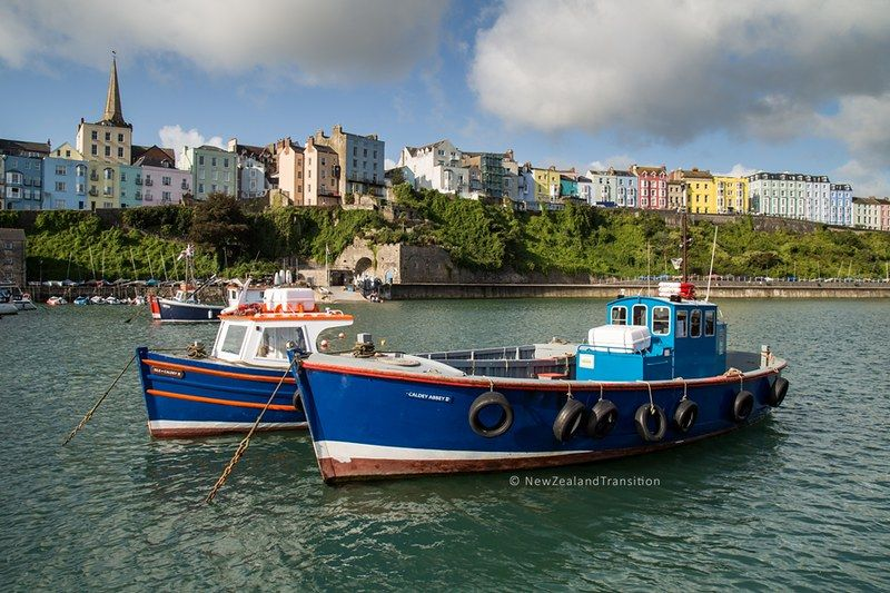 Tenby harbour at high tide with mooring boats and