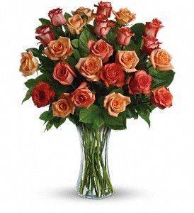 Send her a vase full of sunshine - 24 glorious roses in brilliant shades of orange, light orange and dark orange. Delivered in a sparkling flared vase, this is a dazzling gift that will warm her heart for days - maybe weeks  Presented by Heaven's Scent Flowers.