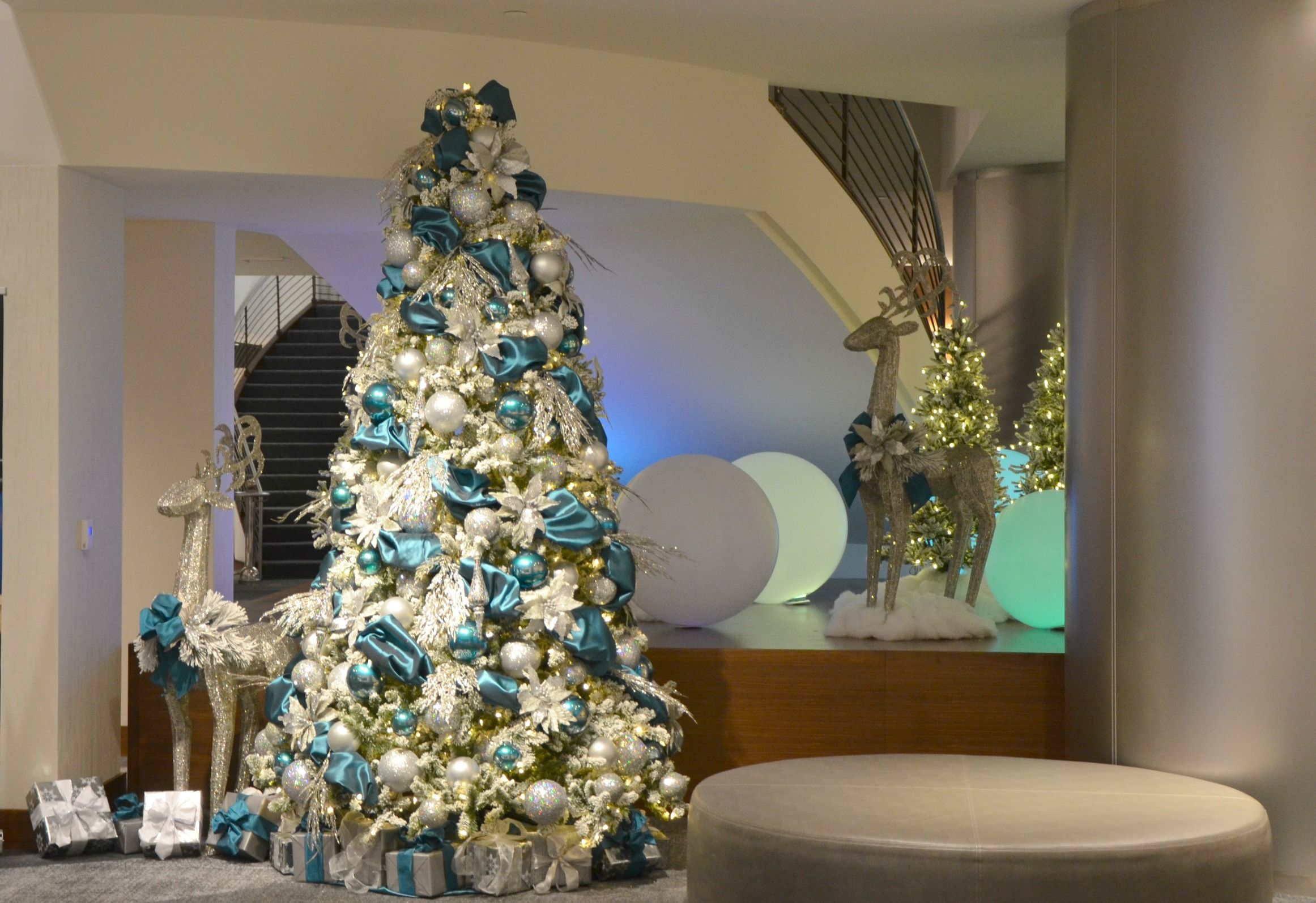 Teal and silver decorated christmas tree rental commercial
