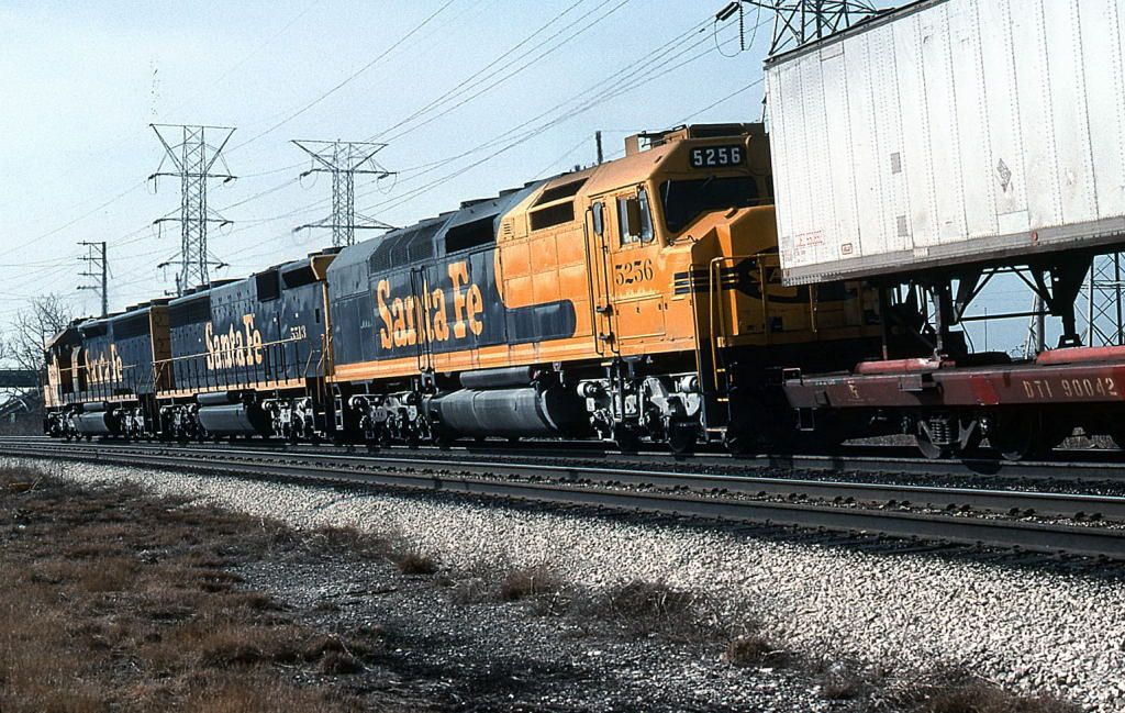 https://flic.kr/p/R1x9pH | Superelevation | A SF40C/SD45-2B/SD45-2 consist is seen passing through the curve at McCook.  02/01/90--Tom Golden photo