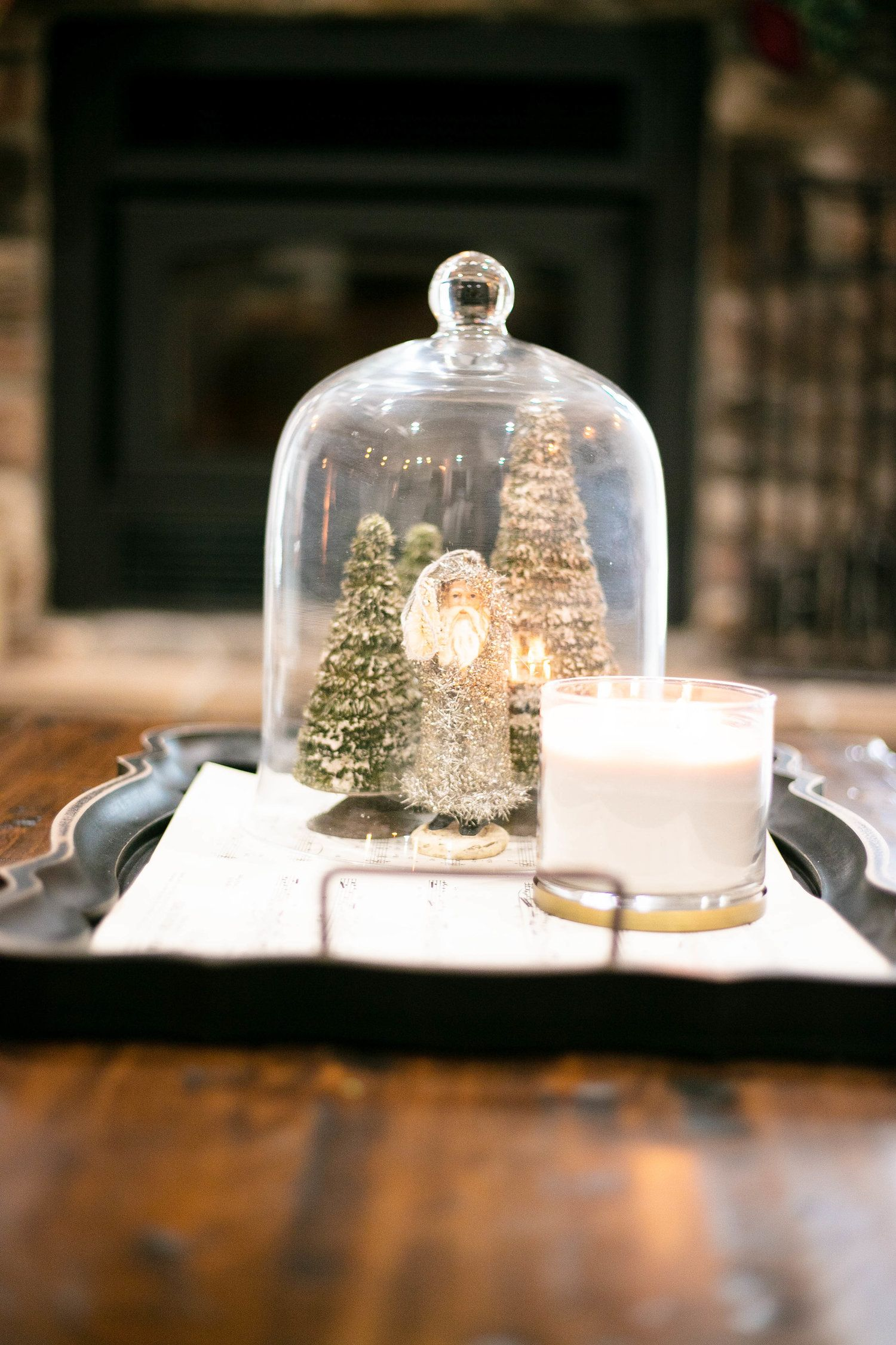 Coffee Table Center Piece With Sheet Music And A Globe With Santa And Tree Figurines Next To A Ca Christmas Coffee Table Decor Christmas Tours Christmas Coffee
