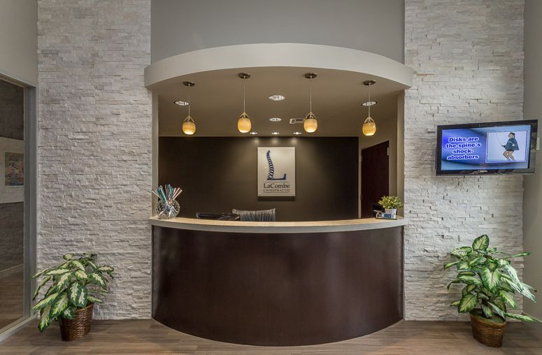 Interesting combo of light stone work with dark wood and for Dental office design 1500 square feet
