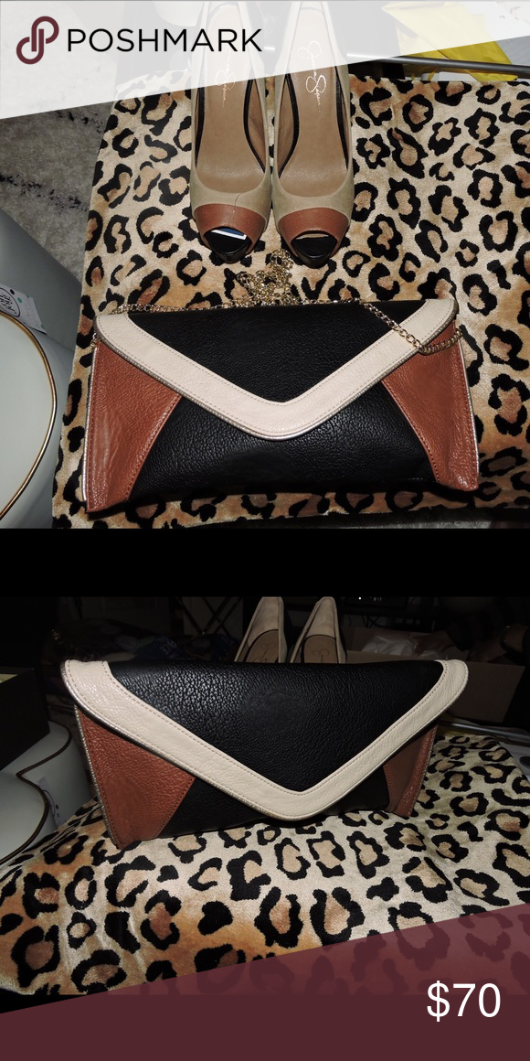 Jessica Simpson Shoes and Matching Bag - brand new Matching Jessica Simpson Clutch and high heeled shoes. Both are brand new and have never been worn. Clutch bag has gold carrying chain. Jessica Simpson Bags Clutches & Wristlets