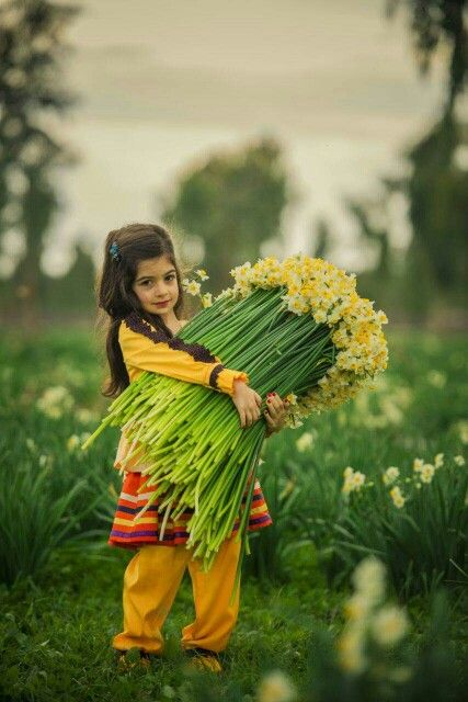 I love this picture, because it reminds me of a memory of picking (probably half as much as the girl in this pic) these exact flowers for my grandmother while walking home in the rain as a child.  The joy in her eyes when face it to her was the best feeling
