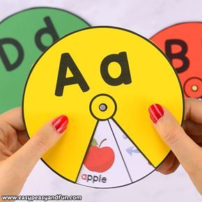 Printable Alphabet Spinners is part of Kids education, Crafts for kids, Teaching kids, Activities for kids, Kids and parenting, Alphabet printables - Help the kids master the alphabet with this printable alphabet spinners  Practice the ABC's or beginning letters with cute images kids will uncover as they spin the wheel  You can make these for your classroom or have the kids make their own if they have the fine motor skills required for this one  this post …
