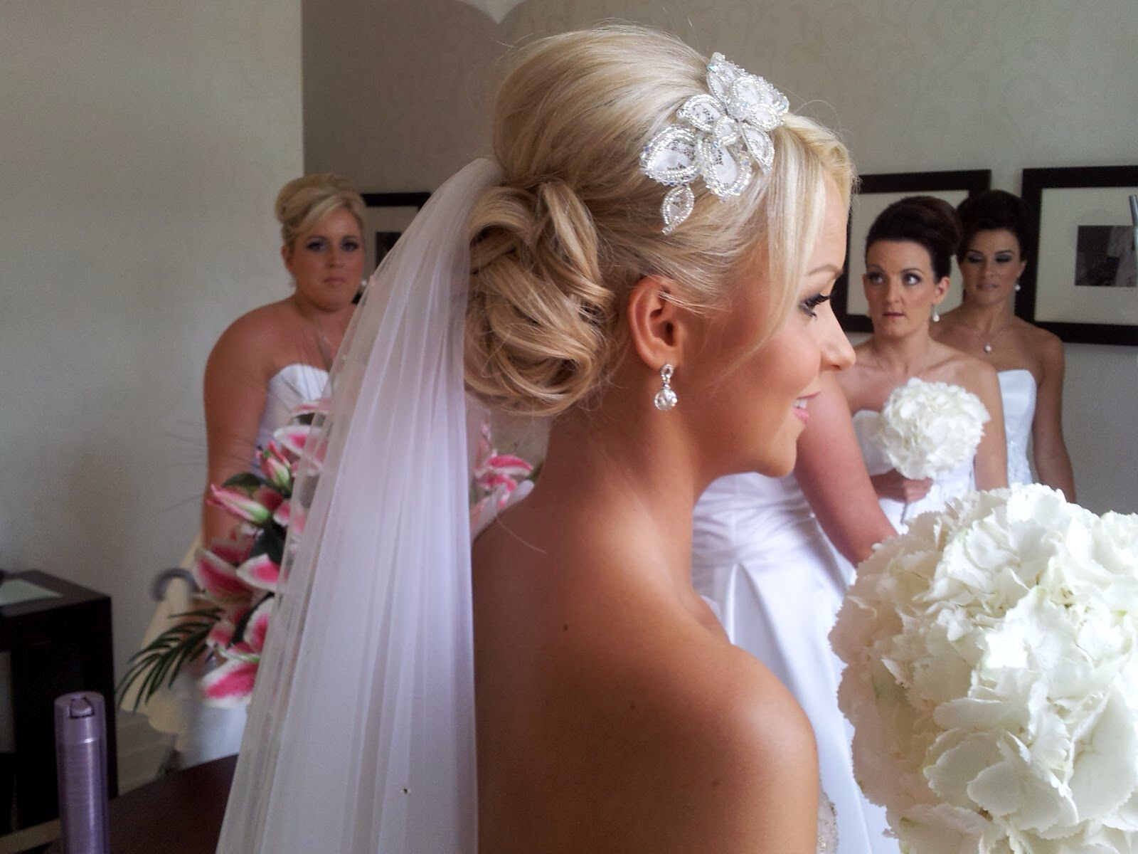 want an updo but with the veil on top  alot seem to be under