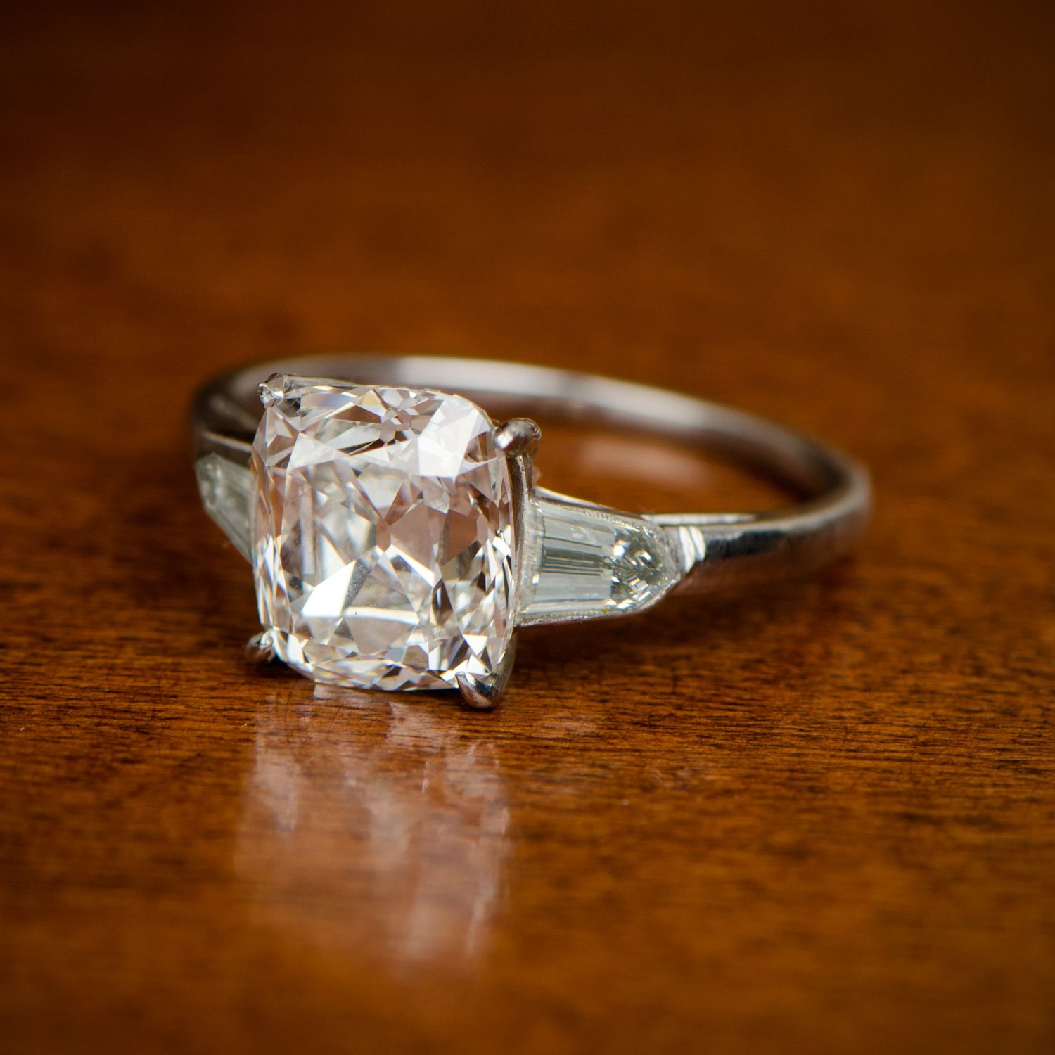 A Stunning Vintage 3 Carat Cushion Cut Diamond Engagement Ring, Adorned By  Lovely Bullet