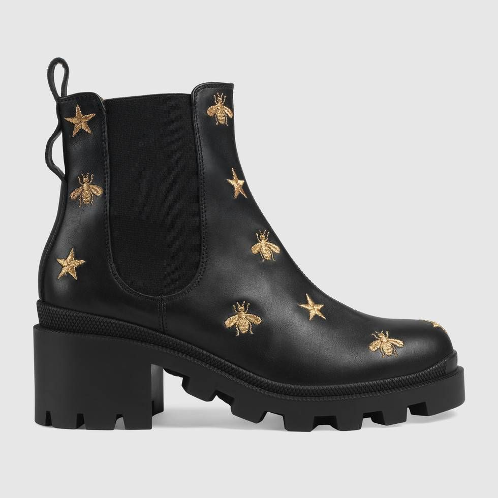 5dc350ed8 Shop the Embroidered leather ankle boot with belt by Gucci. The ankle boot  in embroidered