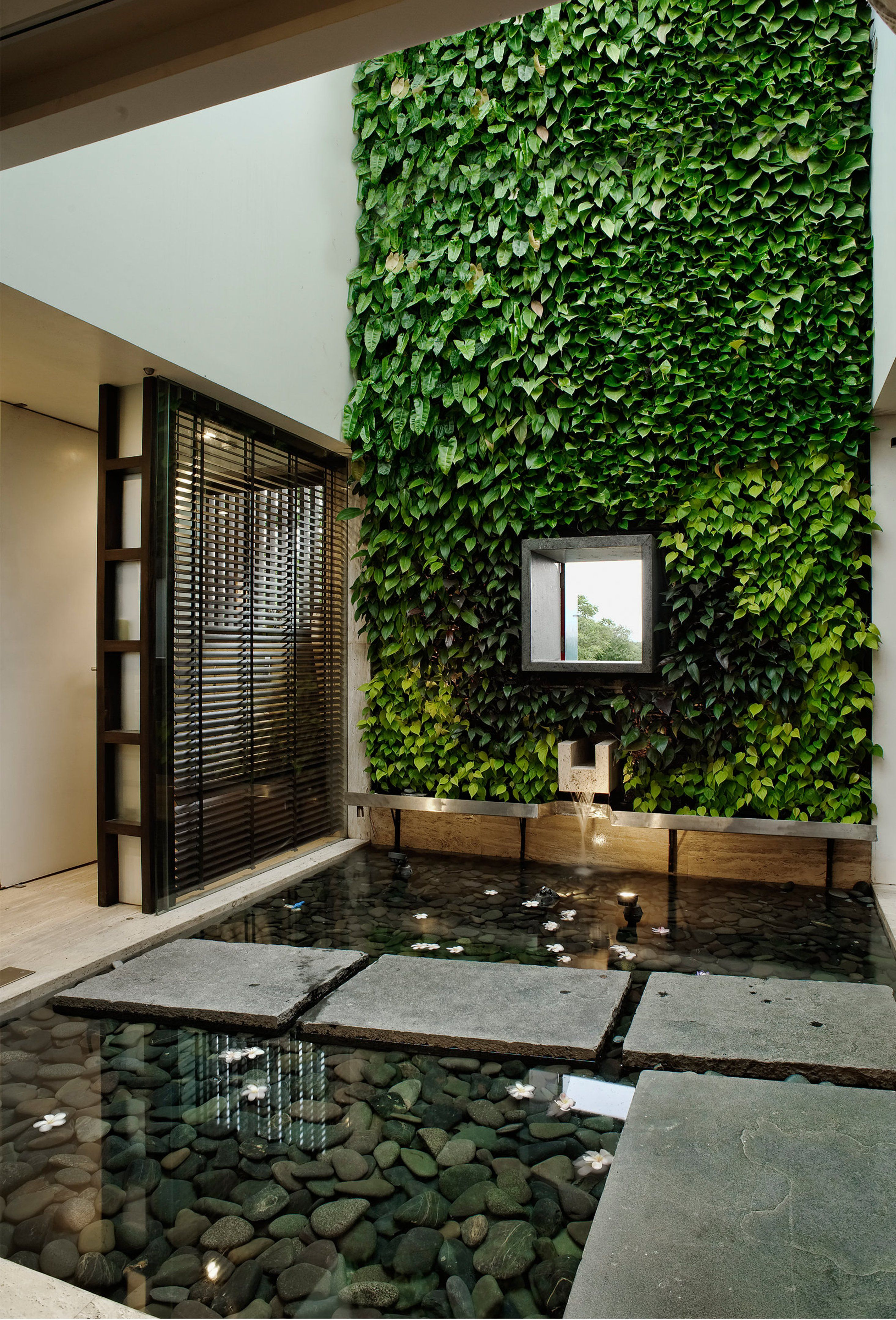 The Courtyard Is Treated With A Full Green Wall With