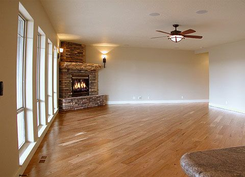 Sconce lights on both sides of corner fireplace light fan with