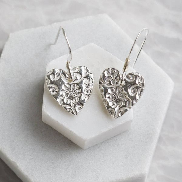 Jenny Grace Jewellery Silver Floral Heart Drop Earrings ($50) ❤ liked on Polyvore featuring jewelry, earrings, silver jewellery, floral drop earrings, silver earrings, heart jewelry and heart shaped earrings