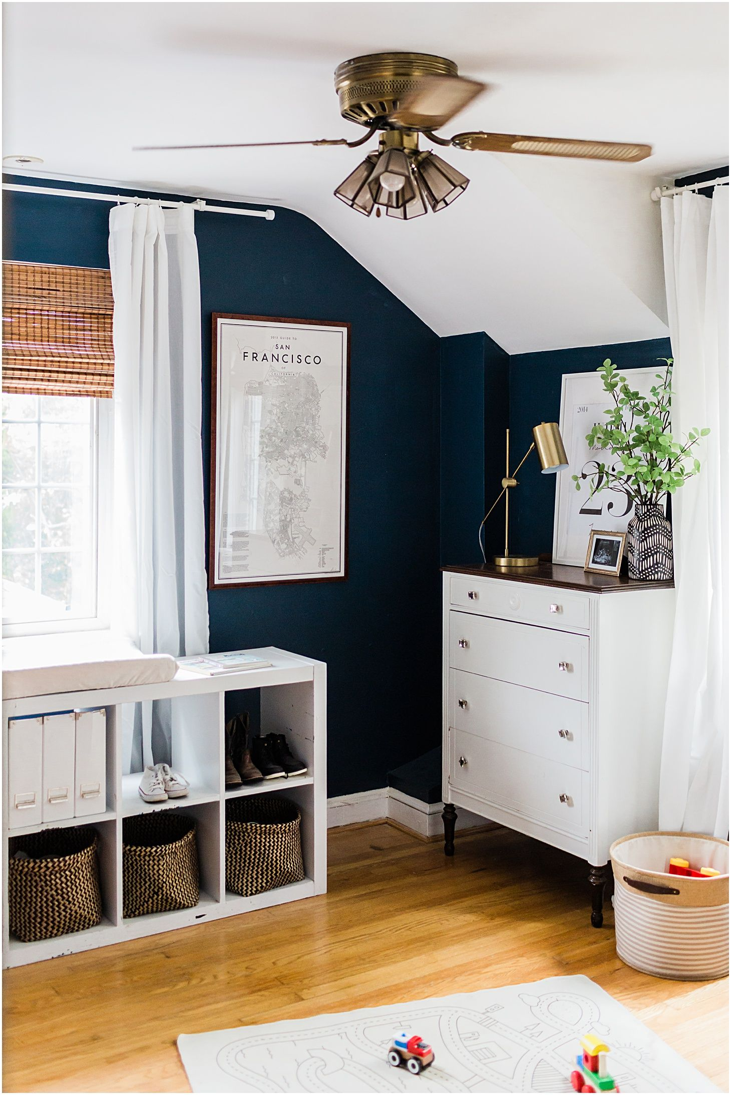 This Navy & White MidCentury Toddler Bedroom combines