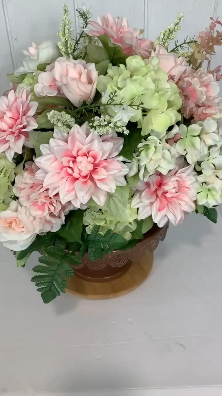 Shades of pink and green make this summer centerpiece perfect for any table or mantle in your home!