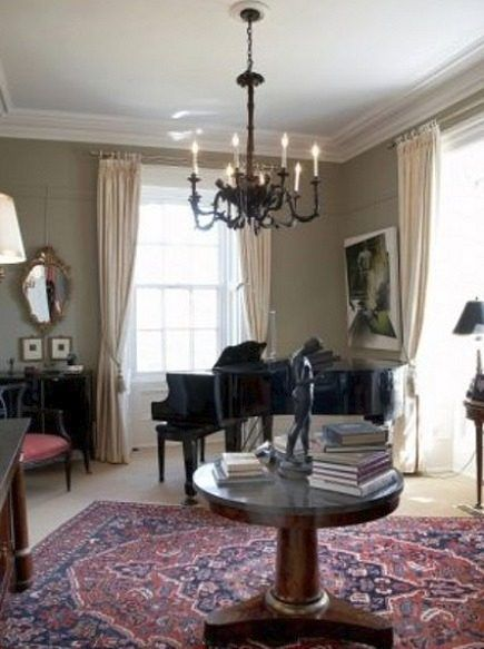 A Circular Hall Table Is A Formal Touch In This Intimate Music Room