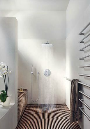 open shower with slatted wood floor and waterfall shower head