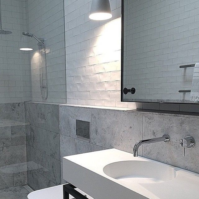 The Omvivo Neo wall basin is the hero of this gorgeous bathroom