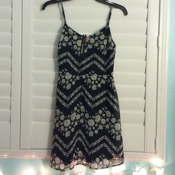 Daisy Pattern Dress Super cute and girly daisy pattern spaghetti strap dress. Straps are adjustable and it's a little stretchy in the back for a nice fit. Extra small but can fit a small as well. Never worn, new, and in perfect condition! Fire Los Angeles Dresses