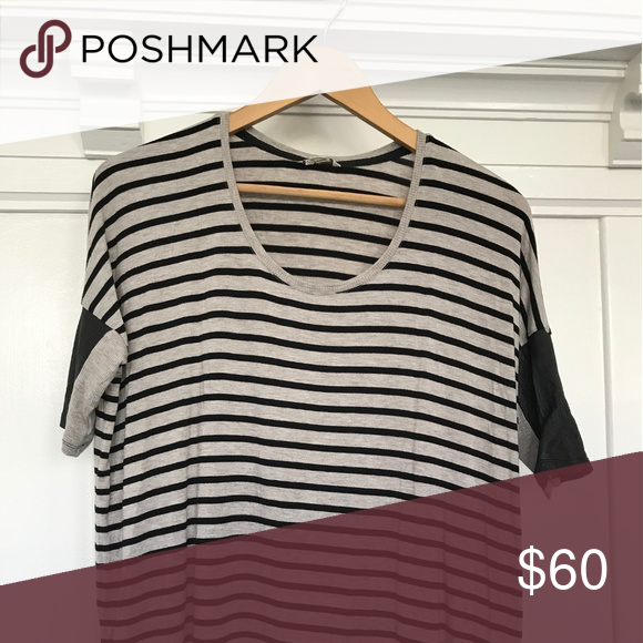 Club Monaco Stripe Tee Cut from a soft cotton and modal blend, this short sleeve knit shirt has a rounded neck, leather trim sleeves, and stripe pattern. Matches well with an athleisure point of view! Club Monaco Tops Tees - Short Sleeve