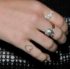 Miley Cyrus Heart Tattoo on her Finger - Check Out Meaning and Story Behind It http://www.popstartats.com/miley-cyrus-tattoos/mc-finger/heart/