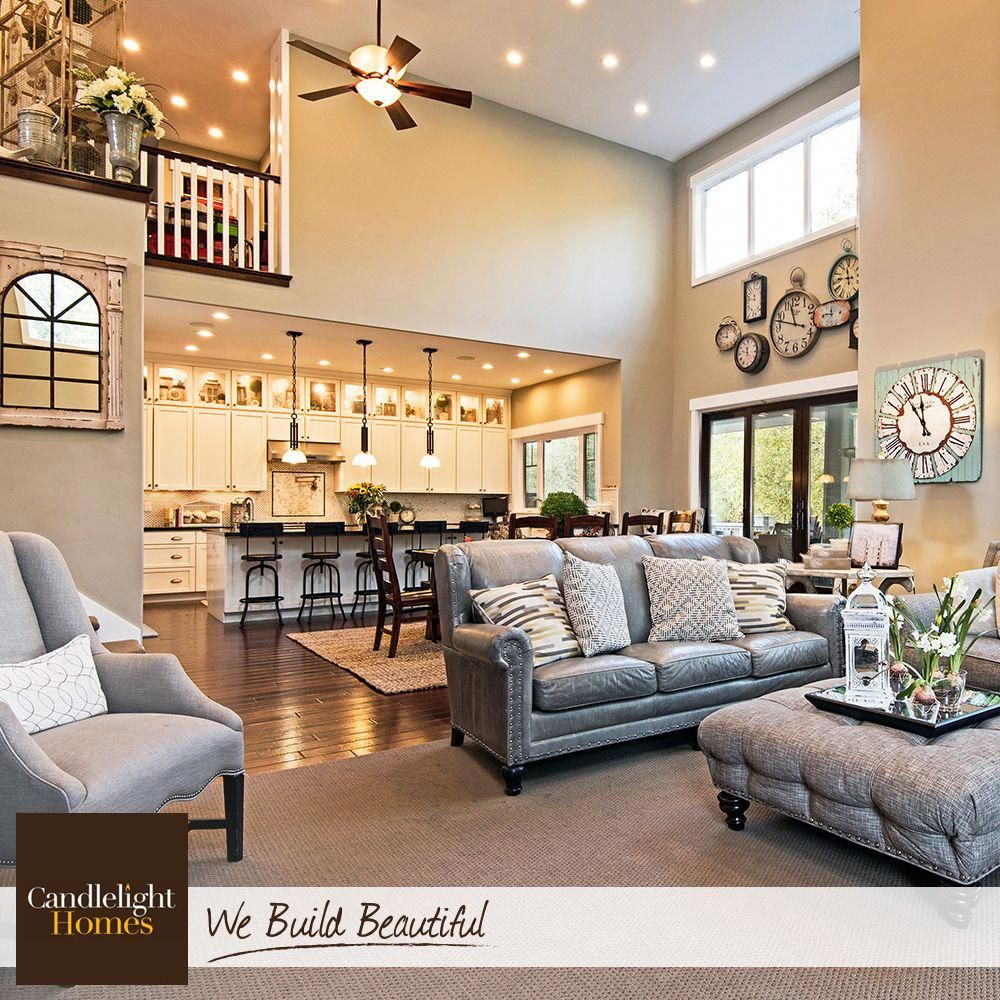 Two-story ceilings, floor-to-ceiling windows, and an open loft create a great room that is much more grand than great.  #CandlelightHomes #utahhomes #utahbuilder #newhomesutah #webuildbeautiful #homedecor #interiordesign #greatroom #home #utah #greatroomdecoratingideas