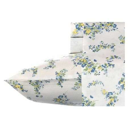 Add feminine-chic flair to your master suite or guest room with this lovely cotton sheet set, featuring a floral motif.   Product:
