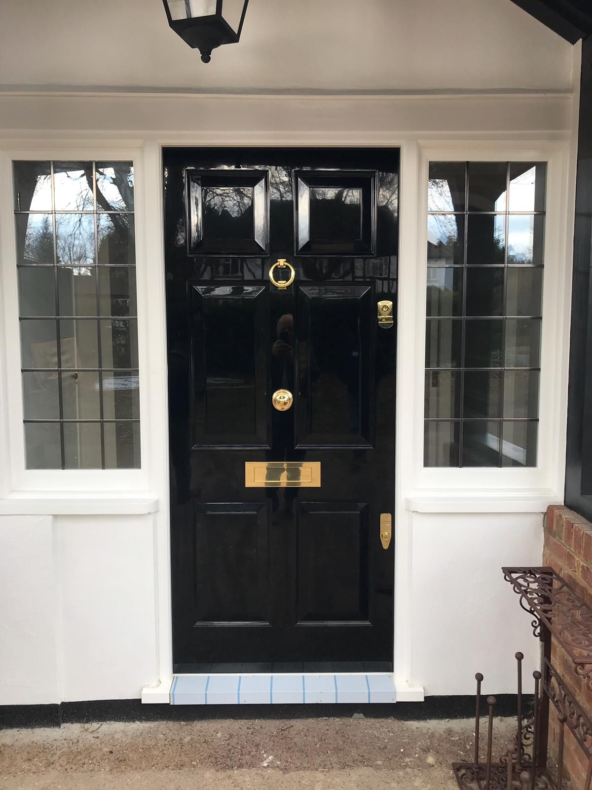Black front door painted with gloss and new banham locks