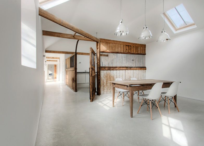 Architecture office AR Design Studio has converted an old stable block in Hampshire, England, into a three-bedroom family house