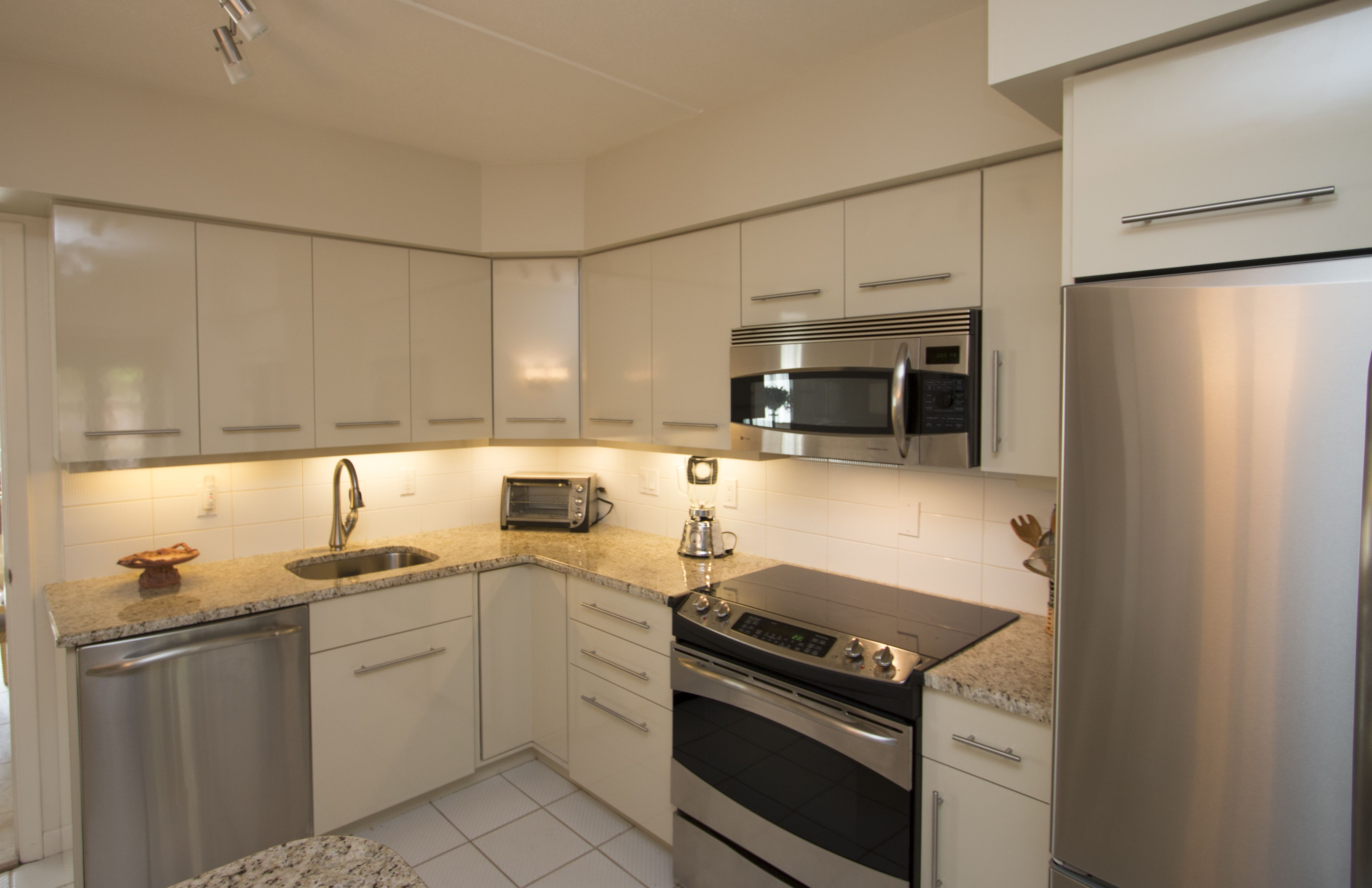 White Kitchen In A Contemporary Style From Falls Church Va The Hardware Is Brushed Nic With Images Contemporary Kitchen Custom Kitchen Cabinets Refacing Kitchen Cabinets