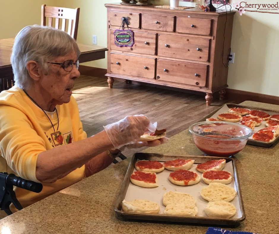 Check out this photo of one of our residents making supper at home! Learn more about our communities at cherrywoodal.com