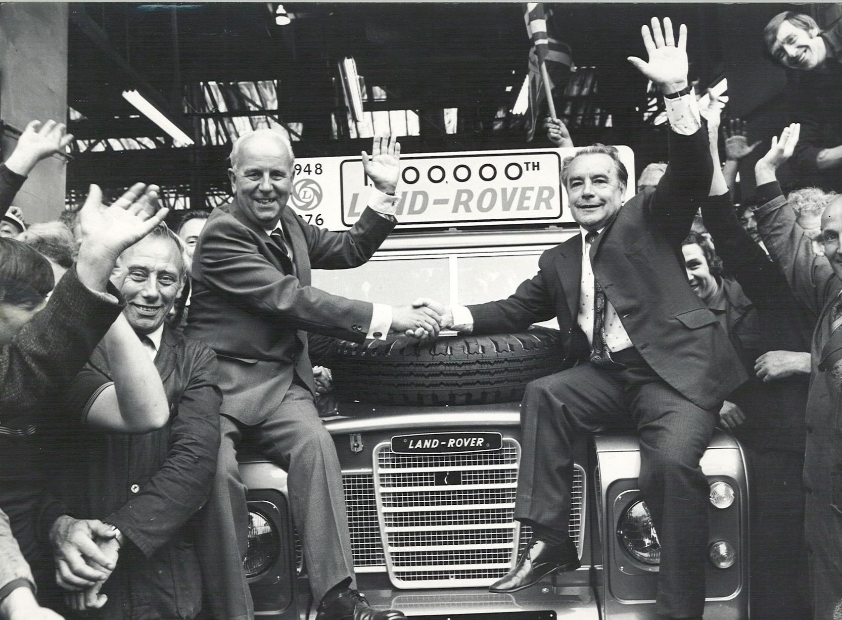The millionth Land Rover comes of the assembly line at Solihull on June 17, 1976, with two veterans of the series perched on the wings. Mr David Kemp (left) has been building the vehicles since production started in 1948, and Mr Tom Barton, known in the factory as Mr Land Rover, helped with the original design.