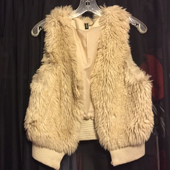 2b600df32 Fur Vest Cream fur vest with hook closures at center front. Minor ...