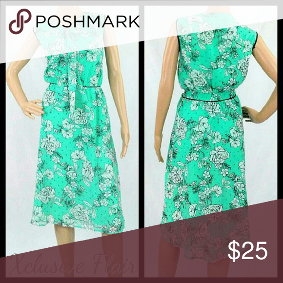 New Floral Dress PRICE FIRM * New never worn without tags * Sleeveless * Sash tie neckline * Elastic in back of waistline * Hidden side zipper * Full lining  NOTE: 10% of sale after fees will be donated to:  💕The American Cancer Society Elle Dresses