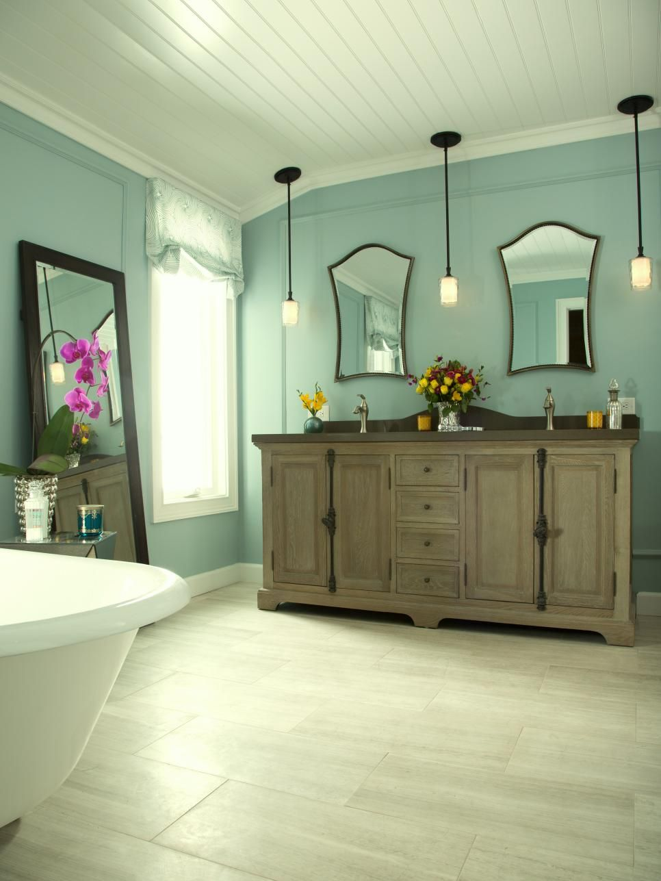 A gorgeous furniture-style vanity is the focal point of this ...