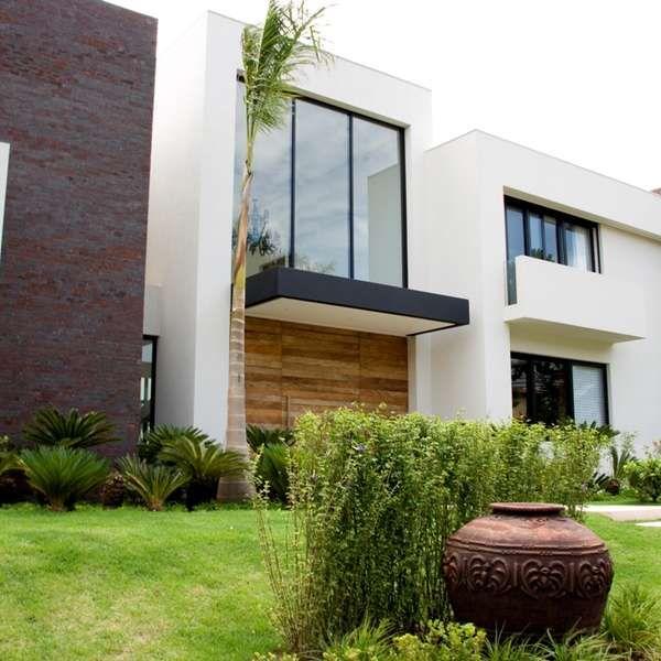 新築住宅の外観アイディア10選 箱型なナウトレンドデザイン: Tijolos Aparentes Dão Conforto E Ar Rústico Aos Ambientes