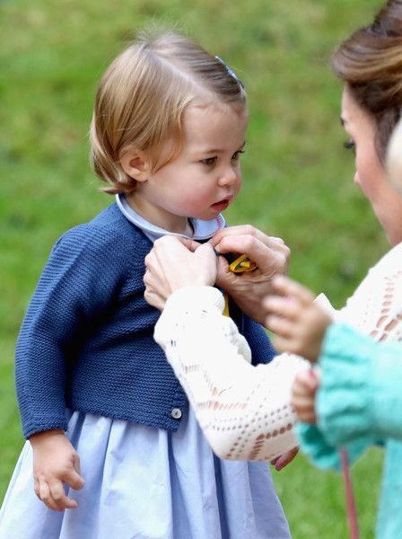 Catherine, Duchess of Cambridge and Princess Charlotte of Cambridge at a children's party for Military families during the Royal Tour of Canada on September 29, 2016 in Victoria, Canada.