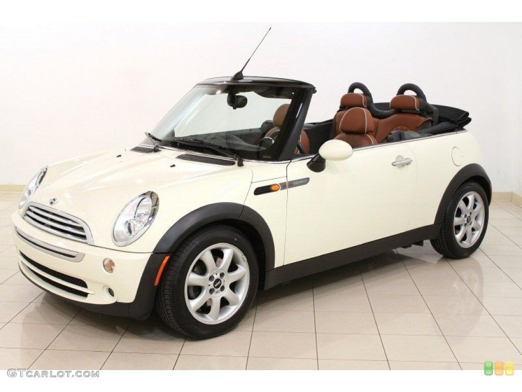 mini cooper white sidewalk convertible