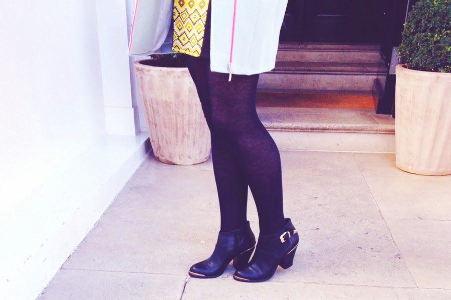 neon-panelled dress, oversize coat, booties, all by Miss Selfridge