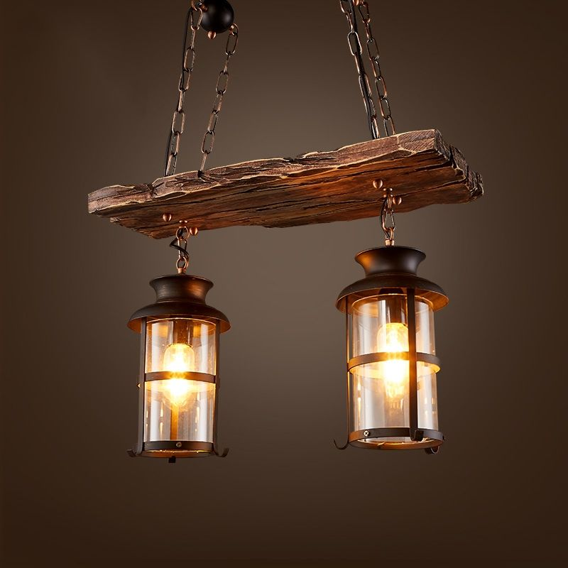 Wanting to add a bit of industrial and rustic to your home decor? This wood beam and glass lantern pendant light is a perfect choice. The weathered wood beam offers a warm brown patina with darker accents, and its rough texture brings in that natural, primitive charisma. Glass lanterns housing the light bulbs provide steady, warm illumination. Chains with round iron balls hold the light fixture to the rectangular canopy and draw the look together. This light fixture offers a functional, stylish