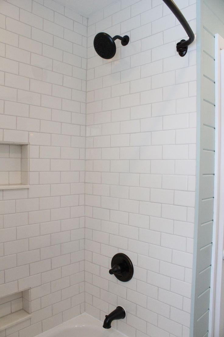 white subway tile shower oil rubbed bronze fixtures bathroom