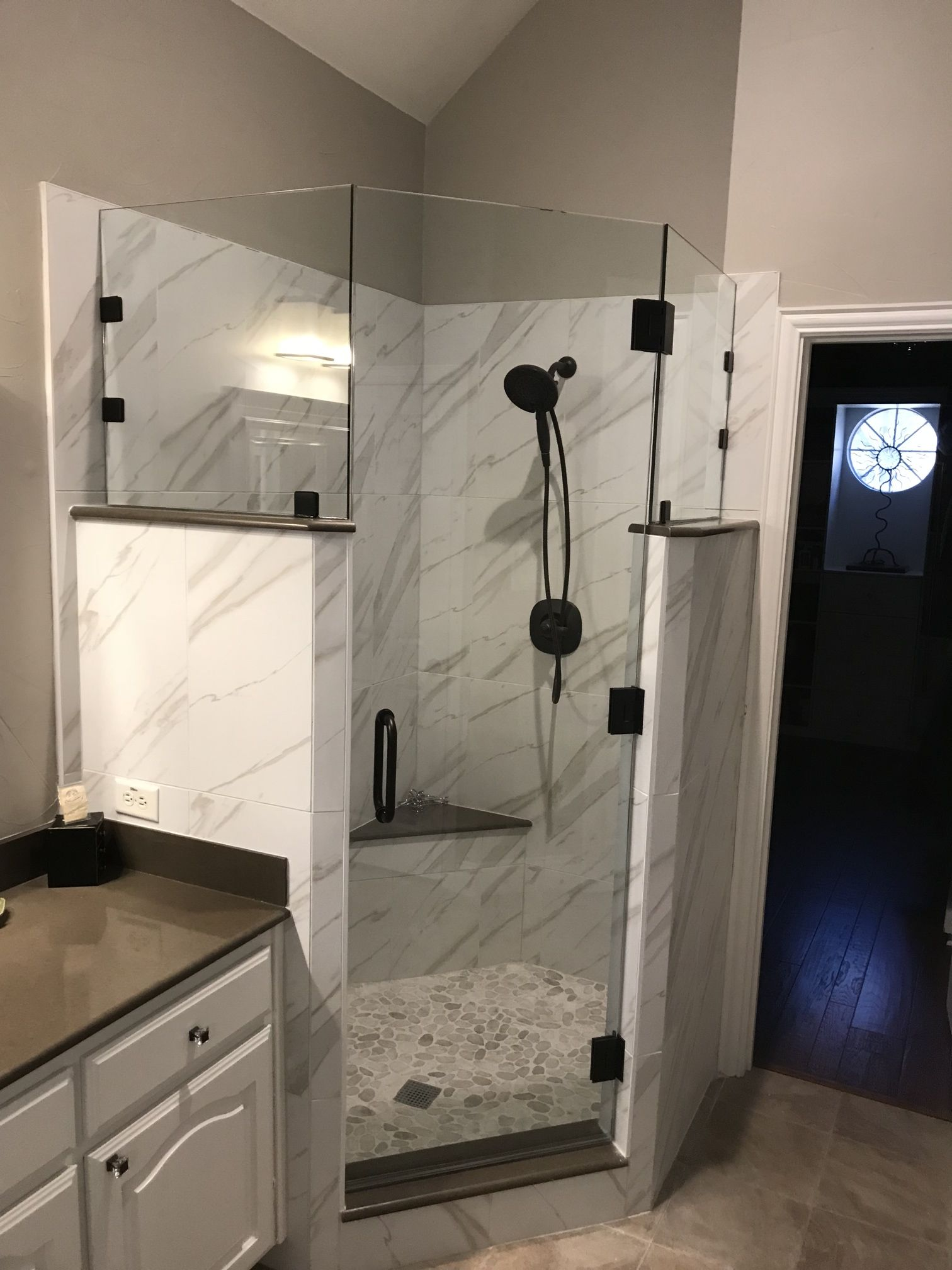 Neo Angle frameless shower with center door Oil rubbed bronze hardware and fixtures Beautiful remodel plete