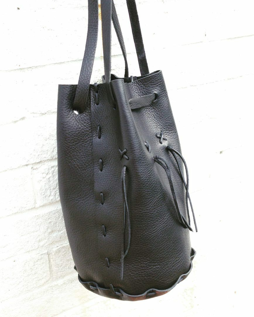 3 way Polly Pouch bag handcrafted in black veg tan leather. Shoulder, cross body or rucksack.