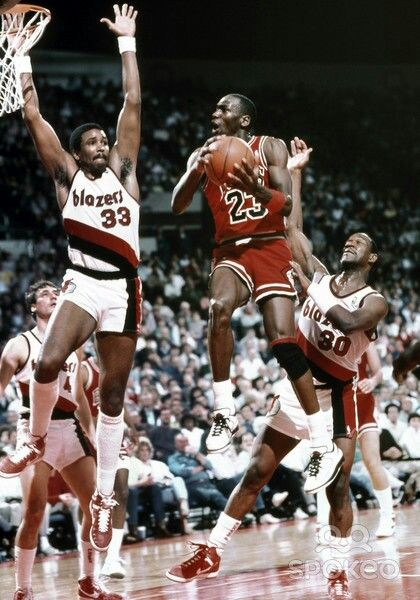 Kevin Duckworth, Terry Porter (Portland Trailblazers) and Michael Jordan
