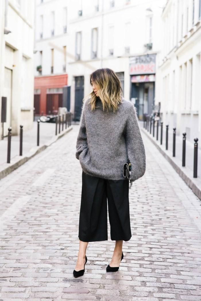 9a030479900 5 Perfect Fall Work Outfit Ideas - Play with proportion by pairing an  oversized sweater with cropped wide pants or culottes. Add black heels to  make it ...