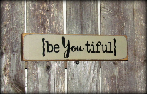 "This sign reads ""BeYoutiful"", it was made to sit on a shelf, atop of a door, window sill, basically it looks good anywhere. It measures 2.5""W x 10""L. It is painted a tan color, then distressed, staine"