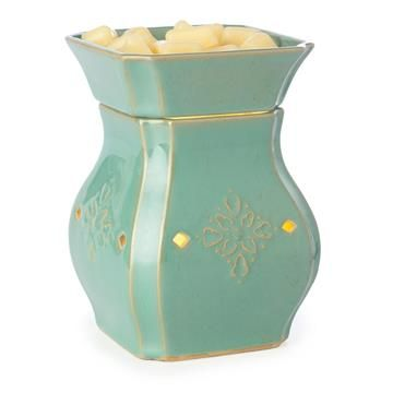 Wonderful turquoise candle warmer to add to your home decor.