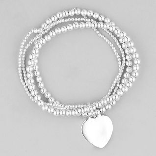 Sterling silver set of 4 ball bracelets on elastic attached with heart tag