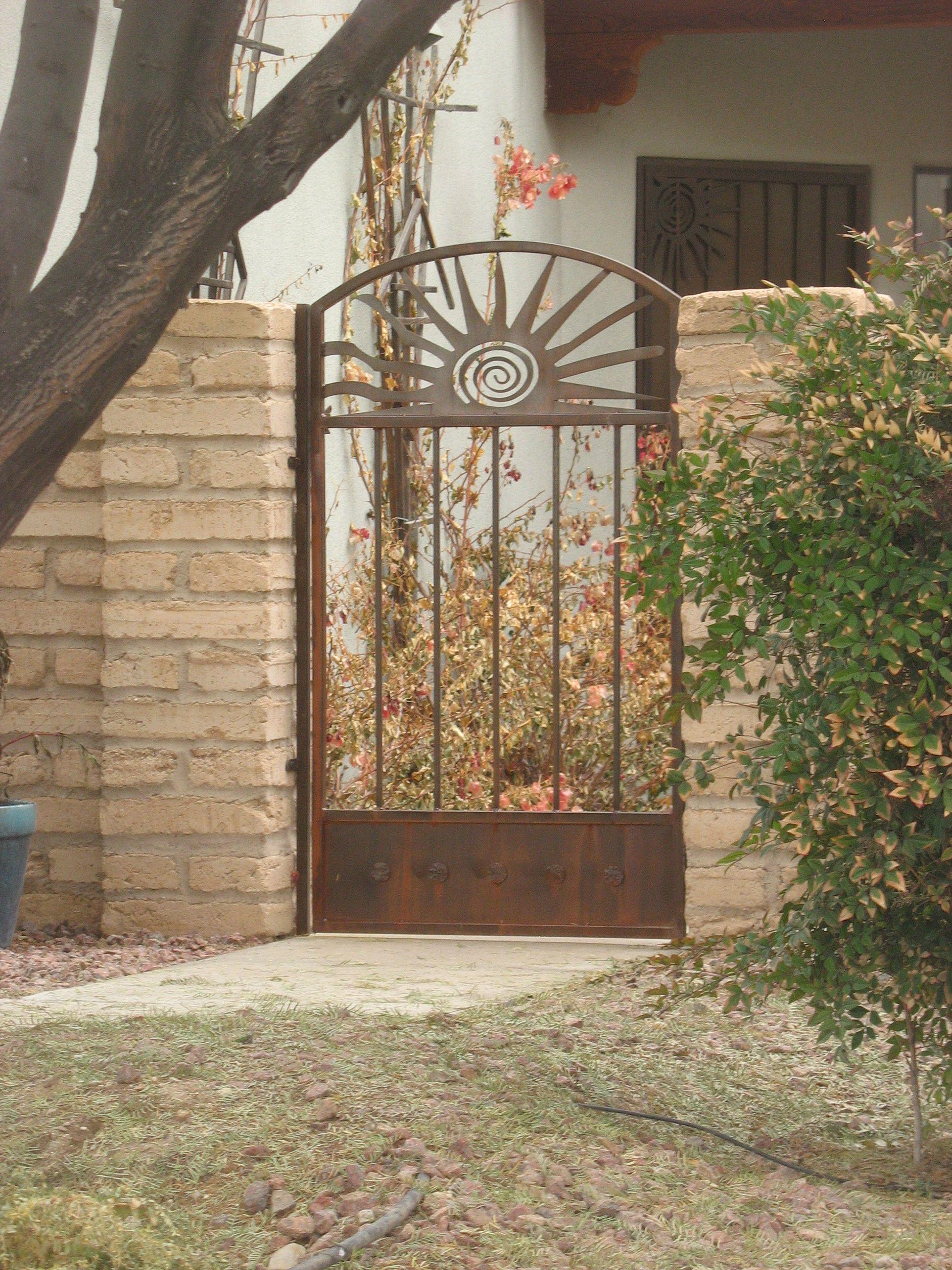 Tucson sunburst gate, photo by Marie Carmean | Iron garden ...