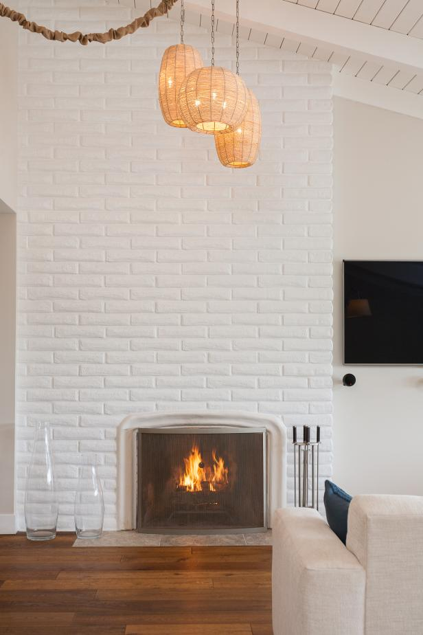 15 Painted Brick Fireplaces That Radiate Coziness #whitebrickfireplace White Brick Fireplace and Lantern Pendants #whitebrickfireplace