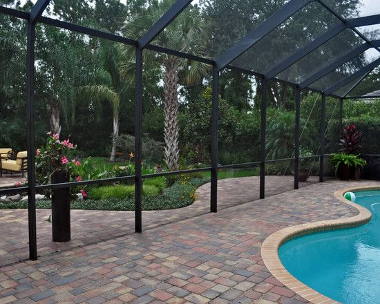 Extend pavers on yard side of pool cage would help keep for Lanai garden designs